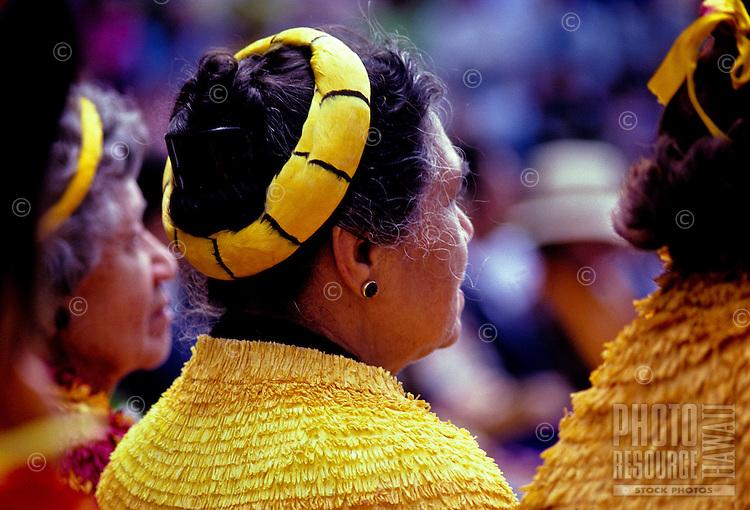 Hawaiian society members, wearing feather lei, at Aloha Week Festivals, Big Island