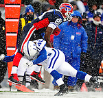 3 January 2010: Buffalo Bills' wide receiver Terrell Owens is tackled by Indianapolis Colts cornerback Jamie Silva during a cold, snowy, final game of the season at Ralph Wilson Stadium in Orchard Park, New York. The Bills defeated the Colts 30-7. Mandatory Credit: Ed Wolfstein Photo