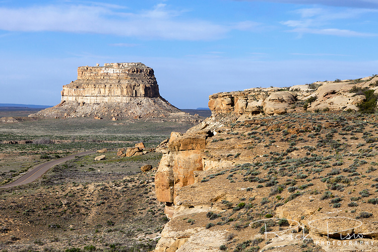 "The 380 foot tall Fajada Butte rises above the valley floor in Chaco Culture National Historic Park. The ruins of about two dozen dwellings have been found in the higher cliff bands, which can be reached now only with rock-climbing gear or via a steep 40-foot ""chimney'' cutting through sandstone rock."