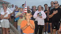 6/11/05.....Gary Wilcox/staff....Hampton Callaghan  was the flag holder for the National Athem  for the Saturday's Lifestyles Realtors Beaches Fine Arts Sprint Triathlon iMicklerÕs Landing in Ponte Vedra Beach. It was the second of this year's three triathlons. The final race in the series will be July 9. Proceeds from the triathlons support the Beaches Fine Arts Series' free concerts and educational programs. The races started with a  run in place of of a quarter-mile ocean swim which did not take place because of the weather, an 11-mile bike, and a 5K (3.1-mile) run. Traffic was expected to be slow at times along the course. The bike course proceeds west from MicklerÕs Landing across Florida A1A onto Mickler Road, turning north at St. Johns County Road 210/Palm Valley Road, to A1A North. Proceeding north on A1A, the cyclists will turn onto Corona Road, traveling east to Ponte Vedra Boulevard. After turning right (south) onto the boulevard, the cyclists return to MicklerÕs Landing. For more information, visit www.bfastriathlon.org..