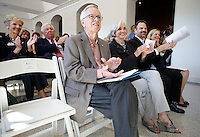 NWA Democrat-Gazette/DAVID GOTTSCHALK  Jim and Joyce Faulkner (from left), Todd Shields, dean of the J. William Fulbright College of Arts and Sciences, and Ronda Mains, chair of the music department, applaud remarks Friday, September 18, 2015 from Dan Ferritor, interim chancellor, during a ribbon cutting ceremony Friday, September 18, 2015 in the lobby of the new Jim and Joyce Faulkner Performing Arts Center on the campus in Fayetteville. Jim and Joyce Faulkner made a $6 million donation to the university in 2012 specifically toward renovating and remodeling the Field House into a performing arts center.