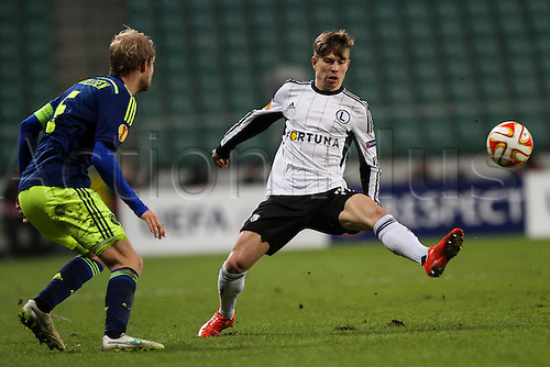 26.02.2015. Warsaw, Poland. Europa League football. Legia Warsaw versus Ajax.  Jakub Kosecki (Legia) and Nicolai Boilesen (Ajax)