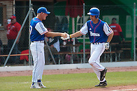 30 july 2010: Robin Allemand of France is congratulated by John Haar as he runs the bases after his solo home run during Italy 9-2 win over France, in day 6 of the 2010 European Championship Seniors, at TV Cannstatt ballpark, in Stuttgart, Germany.