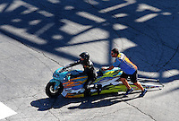 Oct 31, 2015; Las Vegas, NV, USA; NHRA pro stock motorcycle rider Jerry Savoie and a crew member during qualifying for the Toyota Nationals at The Strip at Las Vegas Motor Speedway. Mandatory Credit: Mark J. Rebilas-USA TODAY Sports