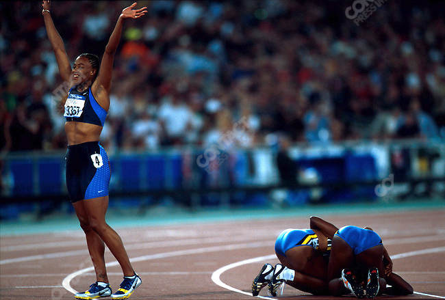 200m, women, Marion Jones (USA) - gold Silver Pauline Davis-Thompson (Bahamas) - silver and Debbie Ferguson (Bahamas) are on the ground, Summer Olympics, Sydney, Australia, September 2000