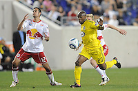Mike Petke (12) of the New York Red Bulls reacts after hitting a clearance off of teammate Tim Ream (5) thast went to Emilio Renteria (20) of the Columbus Crew. Emilio Renteria (20) would score on the play. The Columbus Crew defeated the New York Red Bulls 3-1 during a Major League Soccer (MLS) match at Red Bull Arena in Harrison, NJ, on May 20, 2010.