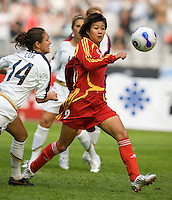 China forward (9) Han Duan lines up for a shot on the ball with USA defender (14) Stephanie Cox close behind during the Four Nations Tournament in  Guangzhou, China on January 20, 2008.  The U.S. defeated China, 1-0, to win the tournament.