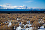 A snowy winter scene of the Three Sisters Mountains in Central Oregon near the town of Bend.