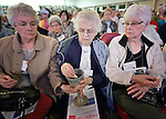 Participants share communion at the United Methodist Women's Assembly during an April 27, 2014 worship service in the Kentucky International Convention Center in Louisville, Kentucky.