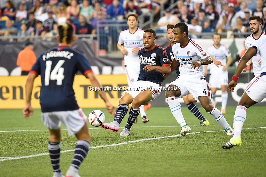 June 13, 2015 - Foxborough, Massachusetts, U.S. - New England Revolution forward Charlie Davies (9) passes the ball to forward Diego Fagundez (14) during the MLS game between Chicago Fire and the New England Revolution held at Gillette Stadium in Foxborough Massachusetts. Eric Canha/CSM