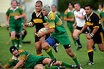 Drury centre C. Anderson sets off upfield after receiving the ball from R. Johnson.  Counties Manukau Premier Club Rugby, Drury vs Bombay played at the Drury Domain, on the 14th of April 2006. Bombay won 34 - 13.