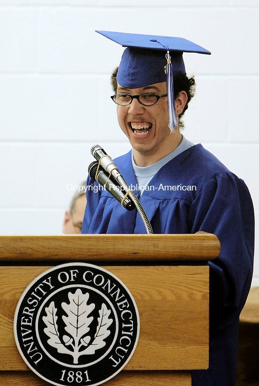 TORRINGTON, CT - 18 JUNE 2005 -061805JS02--Matthew Eteginio, valedictorian for Explorations Charter School, shares a laugh with his classmates as he gives his address during ceremonies at the University of Connecticut-Torrington branch Saturday. The school graduated 20 students this year.    --Jim Shannon Photo--Explorations Charter School  are CQ