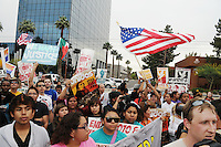 Phoenix, Arizona. April 25, 2012 - Demonstrators rally against SB 1070 at the end of the march's route in front of the ICE building on Central Avenue. About 500 people protested the controversial law on the same day U.S. Supreme Court justices heard legal arguments on the Arizona vs. United States case. At the end of the march, six activists blocked Central Avenue by sitting in the middle of the street. They all were arrested by the Phoenix Police Department and taken to the Fourth Avenue County Jail. Photo by Eduardo Barraza © 2012