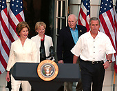 Washington, D.C. - June 15, 2005 -- United States President George w. Bush and first lady Laura Bush, accompanied by Vice President Dick Cheney and his wife, Lynne, walk from the White House to make remarks at the annual Congressional Picnic Reception on the South Lawn of the White House in Washington, D.C. on June 15, 2005.  From left to right: Laura Bush, Lynne Cheney, Vice President Cheney, and President Bush.<br /> Credit: Ron Sachs - Pool via CNP