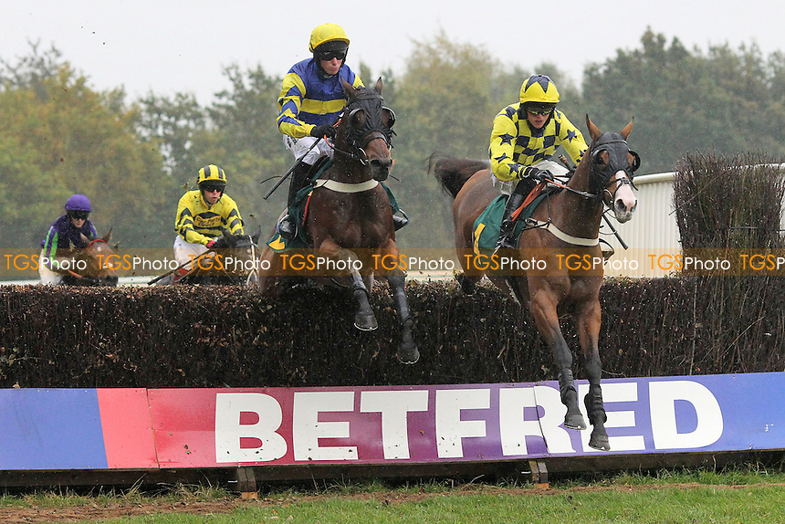 Jawhary ridden by Matthew Stanley and Zepnove ridden by Trevor Whelan (R) in jumping action in the Half Term Racing, Fakenham 26th October Handicap Chase - Horse Racing at Fakenham Racecourse, Norfolk - 19/10/12 - MANDATORY CREDIT: Gavin Ellis/TGSPHOTO - Self billing applies where appropriate - 0845 094 6026 - contact@tgsphoto.co.uk - NO UNPAID USE