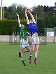 Naomh Mairtin Wayne Campbell Geraldines Paul Clarke. Photo:Colin Bell/pressphotos.ie