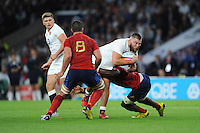 Kieran Brookes of England is tackled by Yannick Nyanga of France as Louis Picamoles of France supports - 15/08/2015 - Twickenham Stadium - London <br /> Mandatory Credit: Rob Munro/Stewart Communications