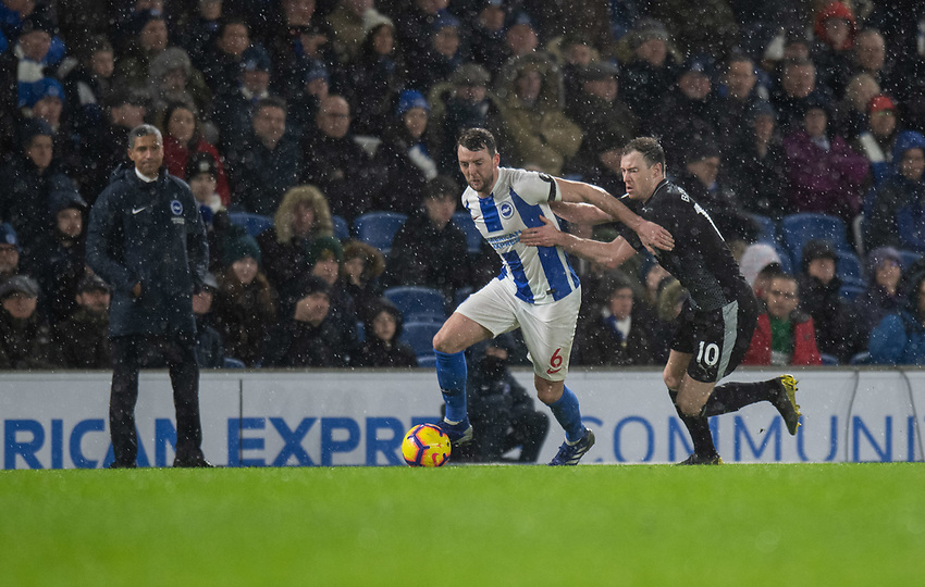 Brighton & Hove Albion's Dale Stephens (left) Burnley's Ashley Barnes as Brighton & Hove Albion manager Chris Hughton  (left) in the background watches his team lose to Burnley 3-0<br /> <br /> Photographer David Horton/CameraSport<br /> <br /> The Premier League - Brighton and Hove Albion v Burnley - Saturday 9th February 2019 - The Amex Stadium - Brighton<br /> <br /> World Copyright © 2019 CameraSport. All rights reserved. 43 Linden Ave. Countesthorpe. Leicester. England. LE8 5PG - Tel: +44 (0) 116 277 4147 - admin@camerasport.com - www.camerasport.com