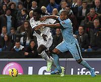 Picture: Andrew Roe/AHPIX LTD, Football, Barclays Premier League, Manchester City v Swansea City, 22/11/14, Etihad Stadium, K.O 3pm<br /> <br /> City's Fernandinho battles with Swansea's Bafetimbi Gomis<br /> <br /> Andrew Roe>>>>>>>07826527594