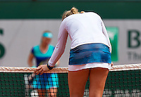 France, Paris , May 26, 2015, Tennis, Roland Garros, Kiki Bertens (NED) hangs frustrated over the net in het match against Svetlana Kuznetsova (RUS)<br /> Photo: Tennisimages/Henk Koster