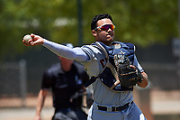 AZL Indians Red catcher Yainer Diaz (4) throws to first base during an Arizona League game against the AZL Indians Blue on July 7, 2019 at the Cleveland Indians Spring Training Complex in Goodyear, Arizona. The AZL Indians Blue defeated the AZL Indians Red 5-4. (Zachary Lucy/Four Seam Images)