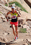 August 15, 2015 - Manitou Springs, Colorado, U.S. - Evergreen, Colorado runner, Brandy Erholtz, works her way through the final steep and rocky pitch on her way to a 2nd place finish in a time of 2:51:38 during the 60th running of the Pikes Peak Ascent.  During the Ascent, runners cover 13.3 miles and gain more than 7815 feet (2382m) by the time they reach the 14,115ft (4302m) summit.  On the second day of race weekend, 800 marathoners will make the round trip and cover 26.6 miles of high altitude and very difficult terrain in Pike National Forest, Manitou Springs, CO.