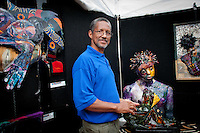 Wycliffe (Linc) Bennett, JMilwaukee, and 260 other artists display their works during the 32nd Annual Naples National Art Festival, one of the top ten art fairs in the country, at Cambier Park, Naples, Florida, USA, Feb. 26, 2011. Photo by Debi Pittman Wilkey