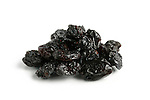 Black raisin close-up Isolated on white background