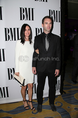 BEVERLY HILLS, CA - MAY 10: Courtney Cox, Johnny McDaid attends the 64th Annual BMI Pop Awards held at the Beverly Wilshire Four Seasons Hotel on May 10, 2016 in Beverly Hills, California.Credit: AMP/MediaPunch.