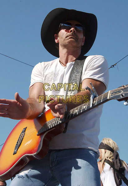 TRICK PONY - KEITH BURNS.2007 CMA Music Festival held at Greased Lightning Daytime Stage at Riverfront Park, Nashville, Tennessee, USA..June 9th, 2007.half length stage concert live gig performance music  sunglasses shades black guitar hat  .CAP/ADM/LF.©Laura Farr/AdMedia/Capital Pictures