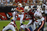 Oct. 16, 2006; Glendale, AZ, USA; Arizona Cardinals punter (10) Scott Player is hit by Chicago Bears cornerback (21) Dante Wesley at University of Phoenix Stadium in Glendale, AZ. Mandatory Credit: Mark J. Rebilas