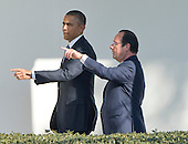 United States President Barack Obama and President Francois Hollande of France walk on the Colonnade to the Oval Office following a State Arrival ceremony on the South Lawn of the White House in Washington, D.C. on Tuesday, February 11, 2014.<br /> Credit: Ron Sachs / CNP