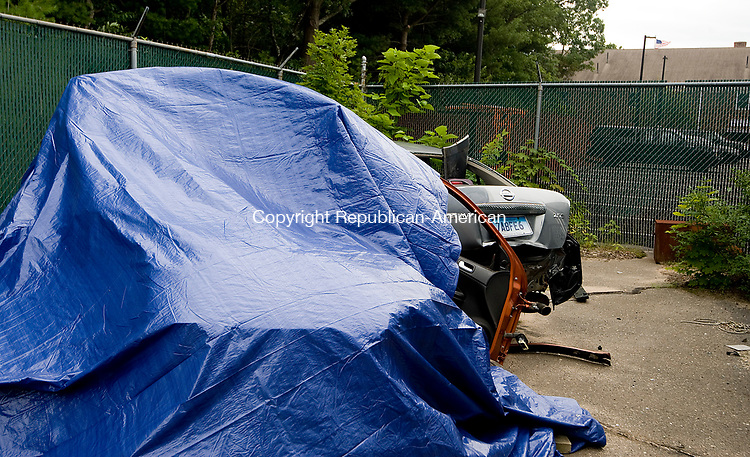 PLYMOUTH, CT-0712917JS01--A 2006 Chevy Cobalt sits under a tarp at the Plymouth Police Department following an accident early Saturday. The accident killed a 17-year-old boy and injured seven. The accident occurred at Town Hill Road at Cross Road in Plymouth. <br /> Jim Shannon Republican-American