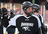 Nick Saracino (PC - 18) -  - The participating teams in Hockey East's first doubleheader during Frozen Fenway practiced on January 3, 2014 at Fenway Park in Boston, Massachusetts.