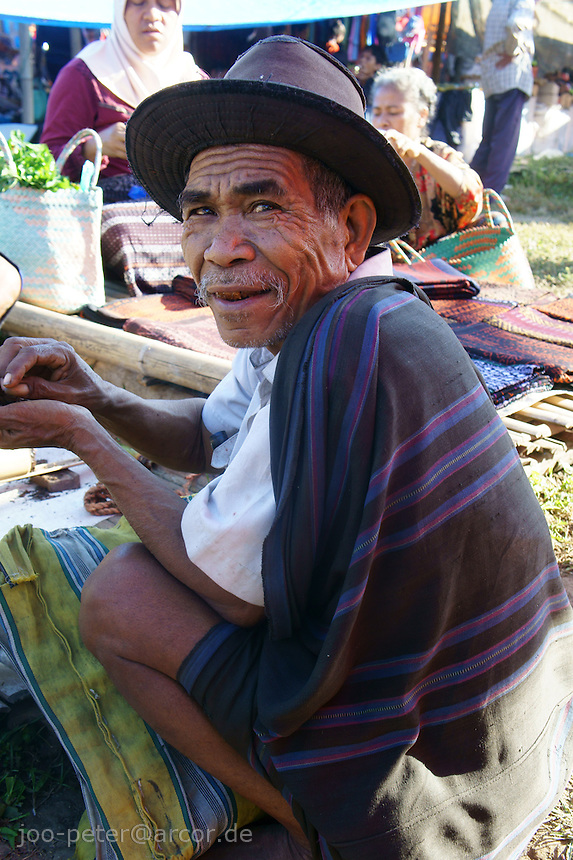 old man on market in Moni, island  Flores in archipelago of Indonesia