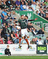 Blackpool's Liam Feeney vies for possession with Plymouth Argyle's Gary Sawyer<br /> <br /> Photographer Kevin Barnes/CameraSport<br /> <br /> The EFL Sky Bet League One - Plymouth Argyle v Blackpool - Saturday 15th September 2018 - Home Park - Plymouth<br /> <br /> World Copyright &copy; 2018 CameraSport. All rights reserved. 43 Linden Ave. Countesthorpe. Leicester. England. LE8 5PG - Tel: +44 (0) 116 277 4147 - admin@camerasport.com - www.camerasport.com