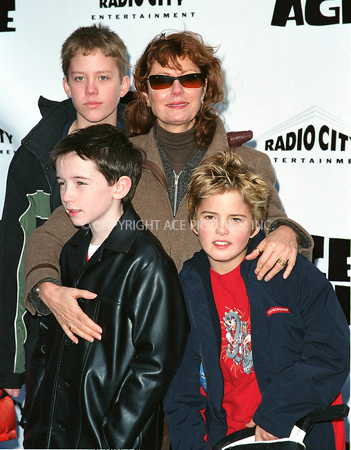 "Actress SUSAN SARANDON with young actor LIAM AIKEN (front, left) and her son MILES (front, right) attend the world premiere of ""Ice Age"" at the Radio City Music Hall in New York. March 10, 2002. © 2002 by Alecsey Boldeskul/NY Photo Press.   ..*PAY-PER-USE*      ....NY Photo Press:  ..phone (646) 267-6913;   ..e-mail: info@nyphotopress.com"