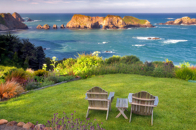 Two chairs on grass overlook at The Harbor House Inn. Elk. California