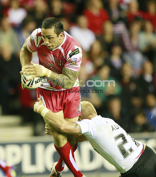 PICTURE BY CHRIS MANGNALL /SWPIX.COM...Rugby League - Super League  - Wigan Warriors v Bradford bulls - DW Stadium, Wigan, England  - 19/08/11... Wigan's  Harrison Hansen tackled by  Bradford's Danny Addy