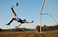 Kettle Run forward Andy Bourdeau executes a bicycle kick during a portrait shoot 3-8-10 at Kettle Run H.S. in Nokesville, VA.