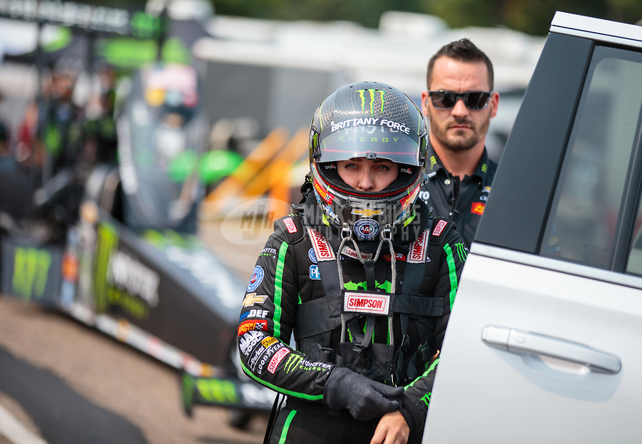 Aug 18, 2018; Brainerd, MN, USA; NHRA top fuel driver Brittany Force with crew member during qualifying for the Lucas Oil Nationals at Brainerd International Raceway. Mandatory Credit: Mark J. Rebilas-USA TODAY Sports