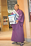 March 22, 2011, Kawasaki City, Kanagawa Prefecture, Japan - A sumo wrestler from a local stable in Kawasaki, Kanagawa Prefecture, Japan, pitch in at Kawasaki Station to gather donations for survivors of the 2011 Tohoku-Kanto Natural Disaster. (Photo by Atsushi Tomura/AFLO)