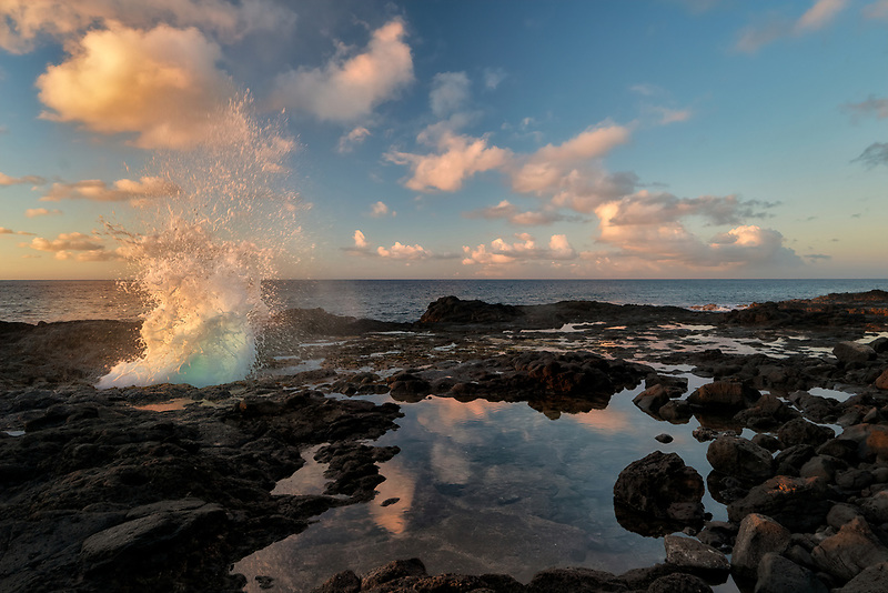 Spouting Horn blow hole at sunrise. Kauai, Hawaii