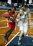 SIOUX FALLS MARCH 22:  TeTe Flowers #00 of Francis Marion drives past Jessica Madison #25 of Alaska Anchorage during their quarterfinal game at the NCAA Women's Division II Elite 8 Tournament at the Sanford Pentagon in Sioux Falls, S.D.  (Photo by Dick Carlson/Inertia)