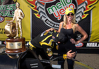 Aug. 4, 2013; Kent, WA, USA: NHRA top fuel dragster driver Morgan Lucas kisses the stomach of pregnant wife Katie Lucas after winning the Northwest Nationals at Pacific Raceways. Mandatory Credit: Mark J. Rebilas-USA TODAY Sports