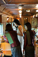 Travelling in style on the Eastern & Oriental Express from Bangkok to Singapore. Staff attend to a guest in the rear bar car.