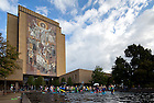 Sep 21, 2013; Residents and friends of St. Edward's Hall jump into the reflecting pool in front of Hesburgh Library before the band marches by on the morning of the Michigan State football game. <br /> <br /> Photo by Matt Cashore