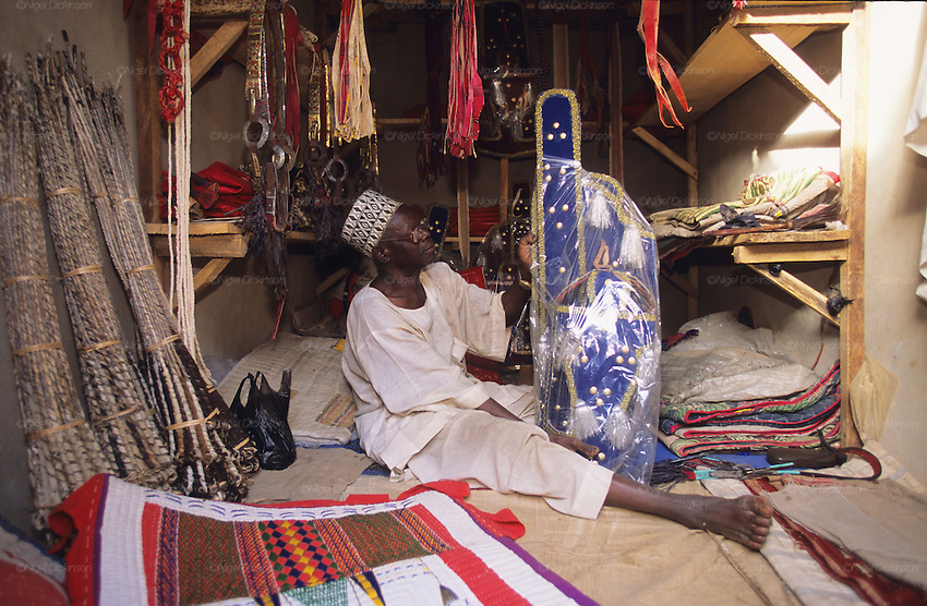 Kano market where all the saddles, leather and accessories are made for the Fantasia celebrations.. The Durbar Fantasia, is the moment where The Husa residents of Kano wear traditional dress, their local leaders and chiefs mount horses, and together with their militias display allegiance and homage to their leader, the Emir of Kano. This takes place after Ramadan. The Emir is Kano's State official political and economic feudal leader, everyone seeks to be in his pleasure, otherwise they reap the consequences..Kano is the largest Muslim Husa city, under the feudal, political and economic rule of the Emir. Kano and the other eleven northern states are under Islamic Sharia Law which is enforced by official state apparatus including military and police, Islamic schools and education, plus various volunteer Militia groups supported financially and politically by the Emir and other business and political bodies. 70% of the population live below the poverty line. Kano, Kano State, Northern Nigeria, Africa