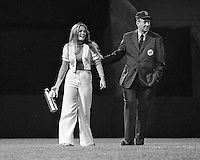 Oakland A'sball girl Debbie Sivyer with outfield umpire Debbie went on to Mrs. Field of Mrs.Fields Cookie fame(1972 photo by Ron Riesterer)