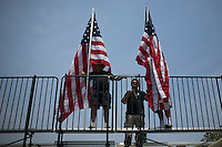 Workers place USA flags while they prepare the stage for the USA's presidential candidate Hillary Clinton before her speech in New York.  12/05/2015. Eduardo MunozAlvarez/VIEWpress